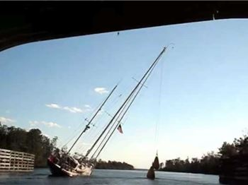 How to fit an 80 ft mast under a 65ft bridge? - Sailing News