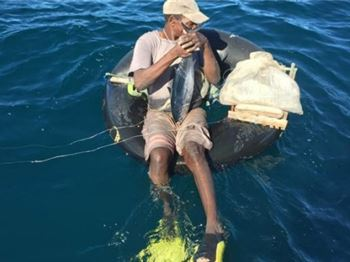 Man found 2km from shore, fishing from an inner tube! - Fishing News