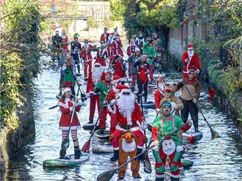SUPing Santas Take Over A River!