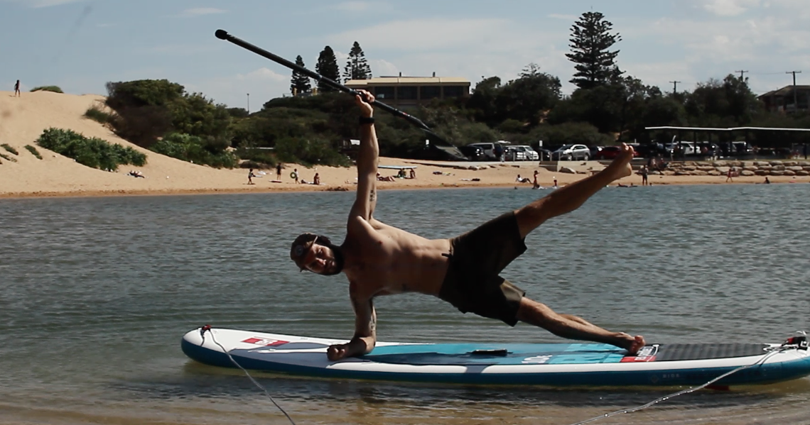 Side plank on Red Paddle Co board