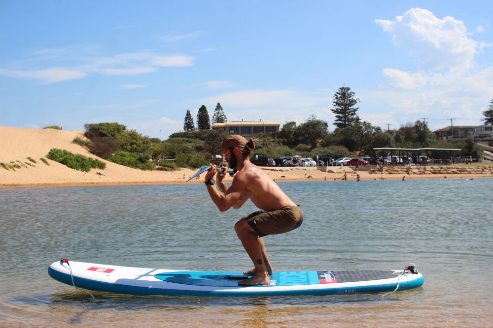 Squats on inflatable stand up paddle board