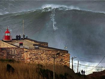 Surfers ride 140ft waves in Portugal - Surfing News
