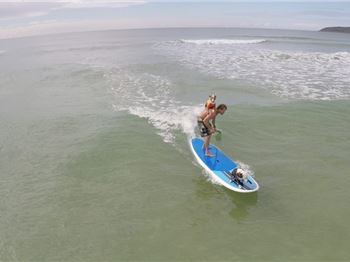 'Top dog' Chris De Aboitiz's new dog SUP surfing trick - Stand Up Paddle News