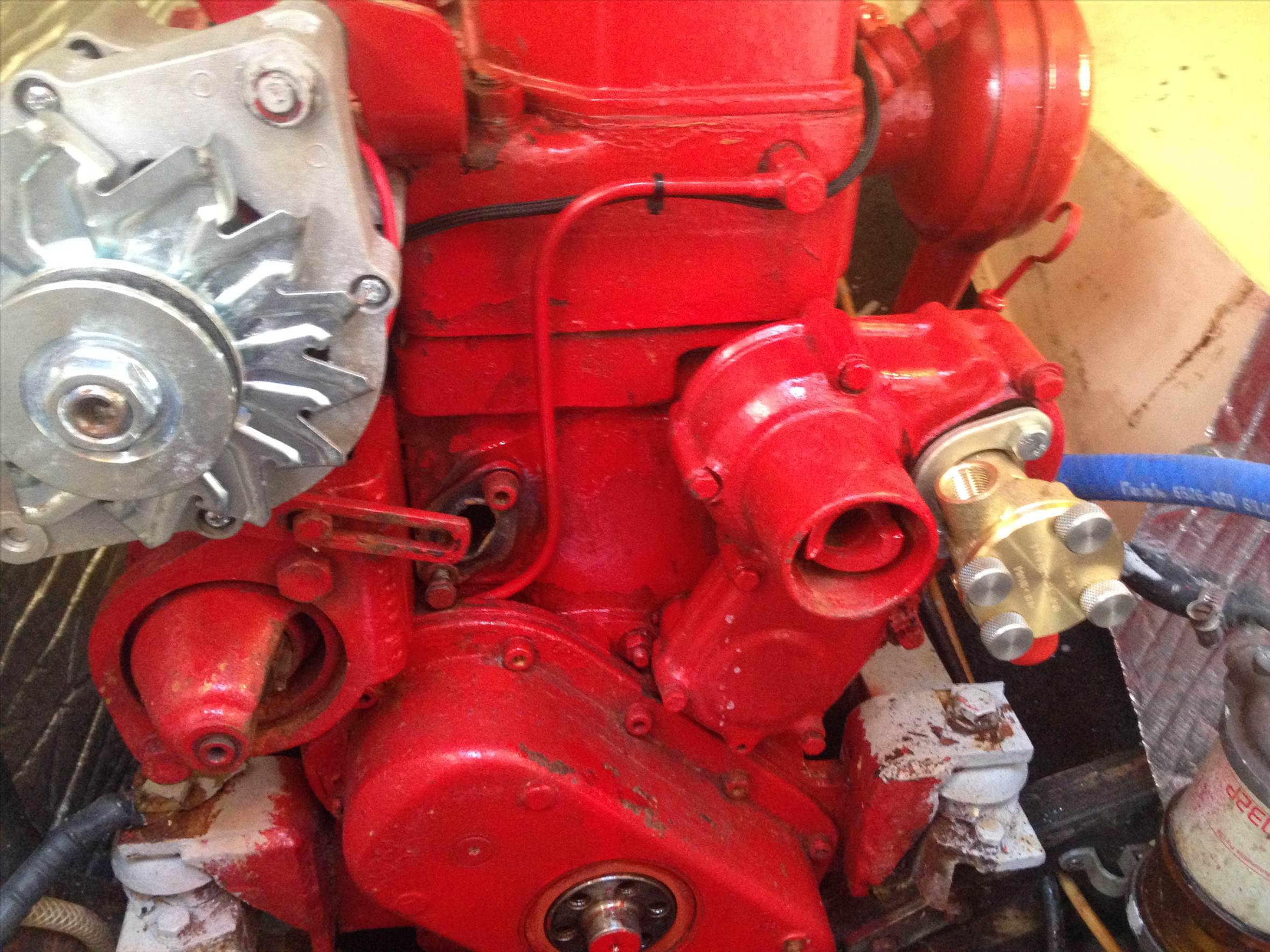 To the right of the alternator adjusting bracket the inlet tubing focuses  on the rear cylinder to assit cooling it and there had two paths out of the  engine